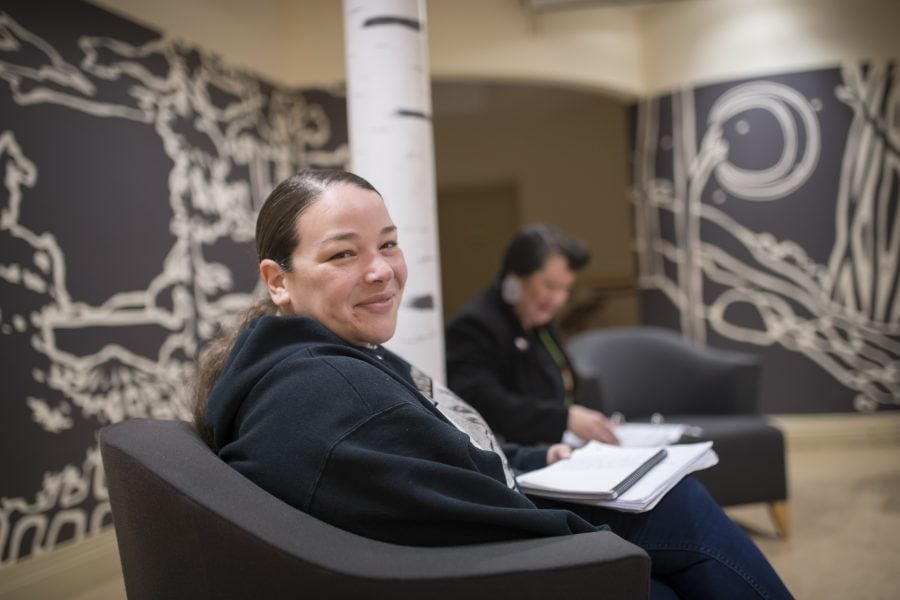 Indigenous student smiling in turtle lounge